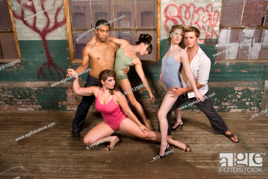 Stock Photo: Dancers posing in an old factory.