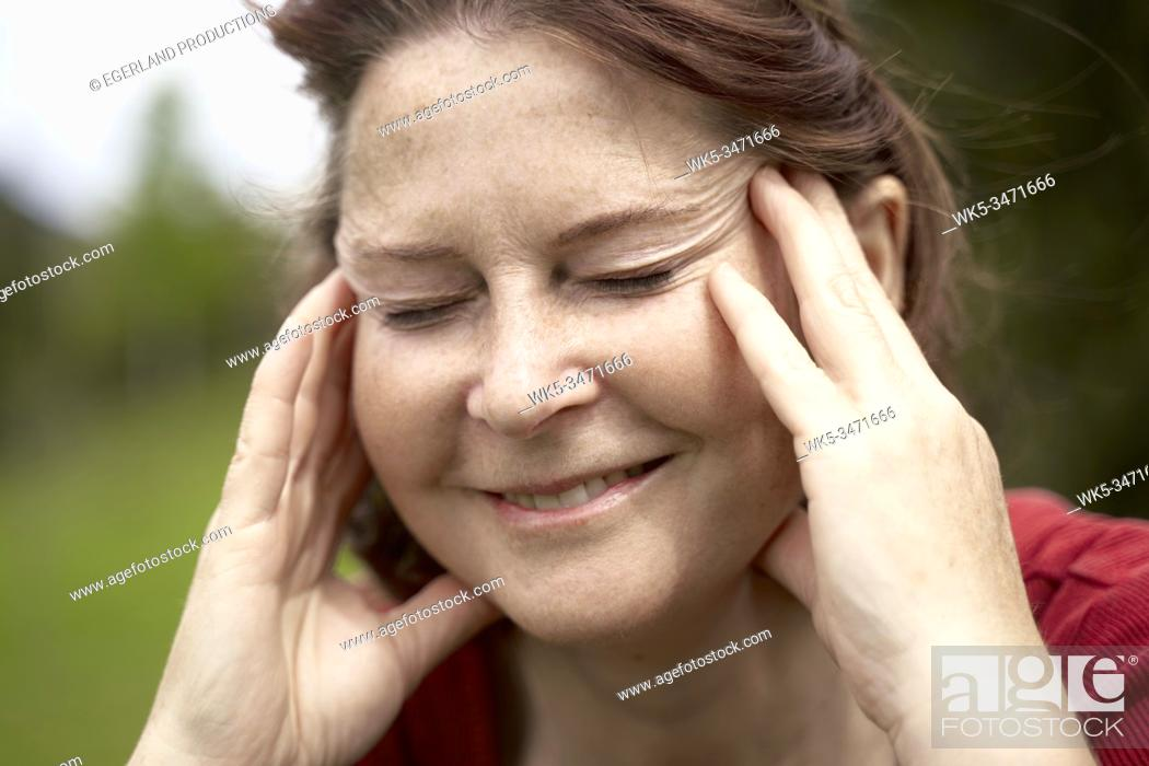 Stock Photo: Mature woman in countryside with eyes closed, close up. Bad Tölz, Upper bavaria, Germany.