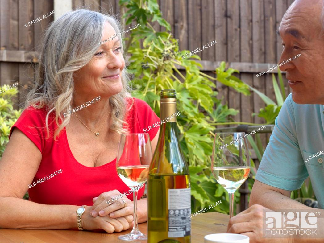 Stock Photo: Older couple drinking wine together.