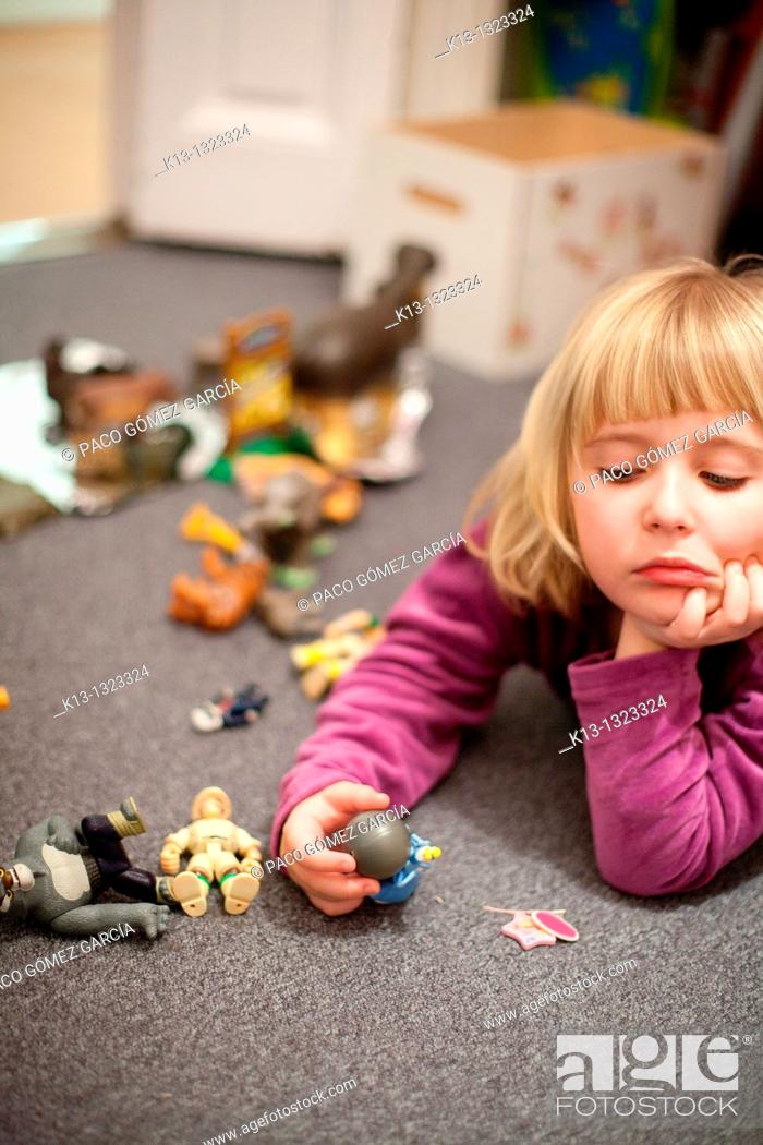 Stock Photo: Boring girl while playing.