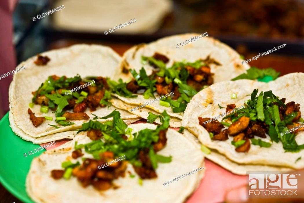 Stock Photo: Close-up of four Mexican tacos on a plate, Cuetzalan, Puebla State, Mexico.