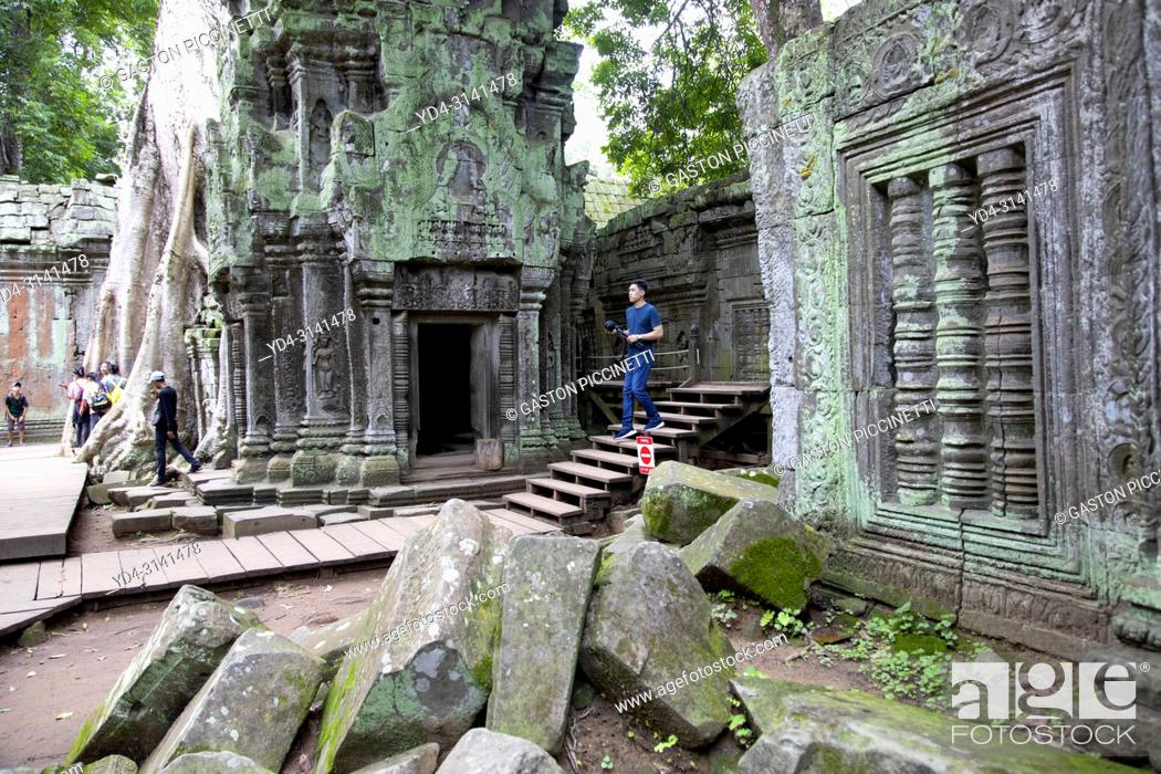 Stock Photo: Tourists in Ta Prohm temple in Angkor Wat, Siem Reap, Cambodia. Ta Prohm is the modern name of the temple at Angkor, Siem Reap Province, Cambodia.