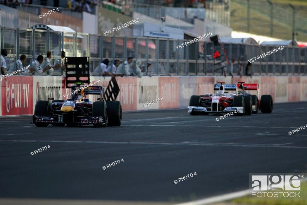 Stock Photo: Race, Sebastian Vettel, Red Bull Racing, RB5 race winner leads Jarno Trulli, Toyota F1 Team, TF109 2nd positiont, Grand Prix, 04/10/2009, Suzaka, Japan.