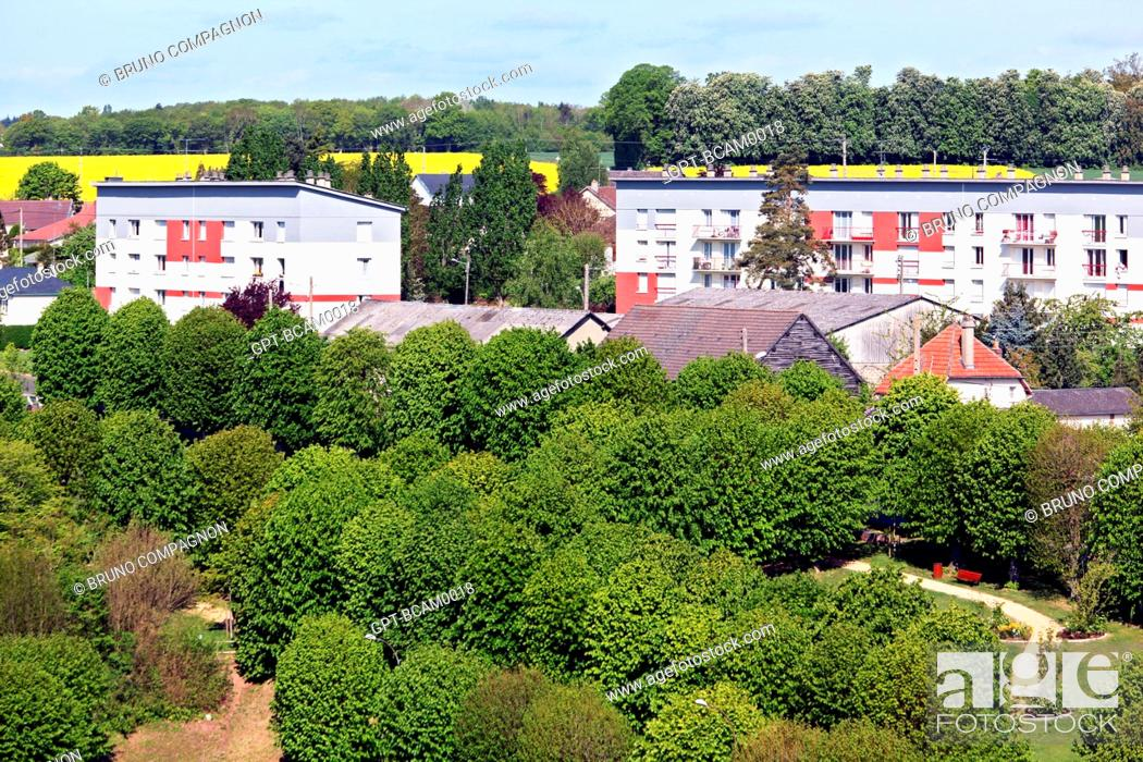 Imagen: HOUSING PROJECT BEHIND A TREE-FILLED PARK, RUGLES, EURE 27, UPPER NORMANDY, FRANCE, EUROPE.