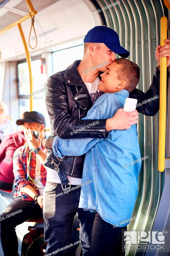 Stock Photo: Romantic young couple hugging on city tram.
