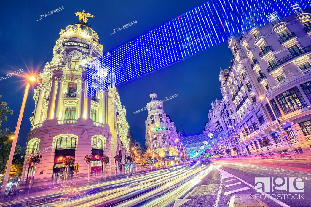 Stock Photo: Grassy building and Gran Via street at Christmastime. Madrid. Spain.