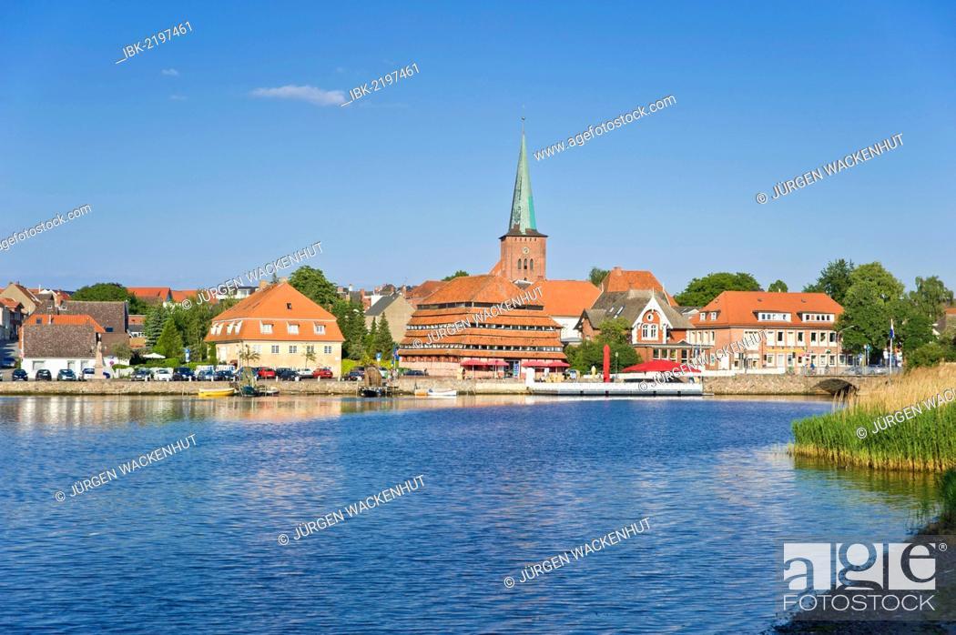 Stock Photo: View of Neustadt, lake Neustaedter Binnenwasser, the church and Pagodenspeicher building, Neustadt in Holstein, Schleswig-Holstein, Germany, Europe.