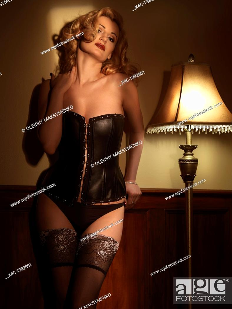 Stock Photo: Glamour photo of a woman in her thirties wearing black lingerie.