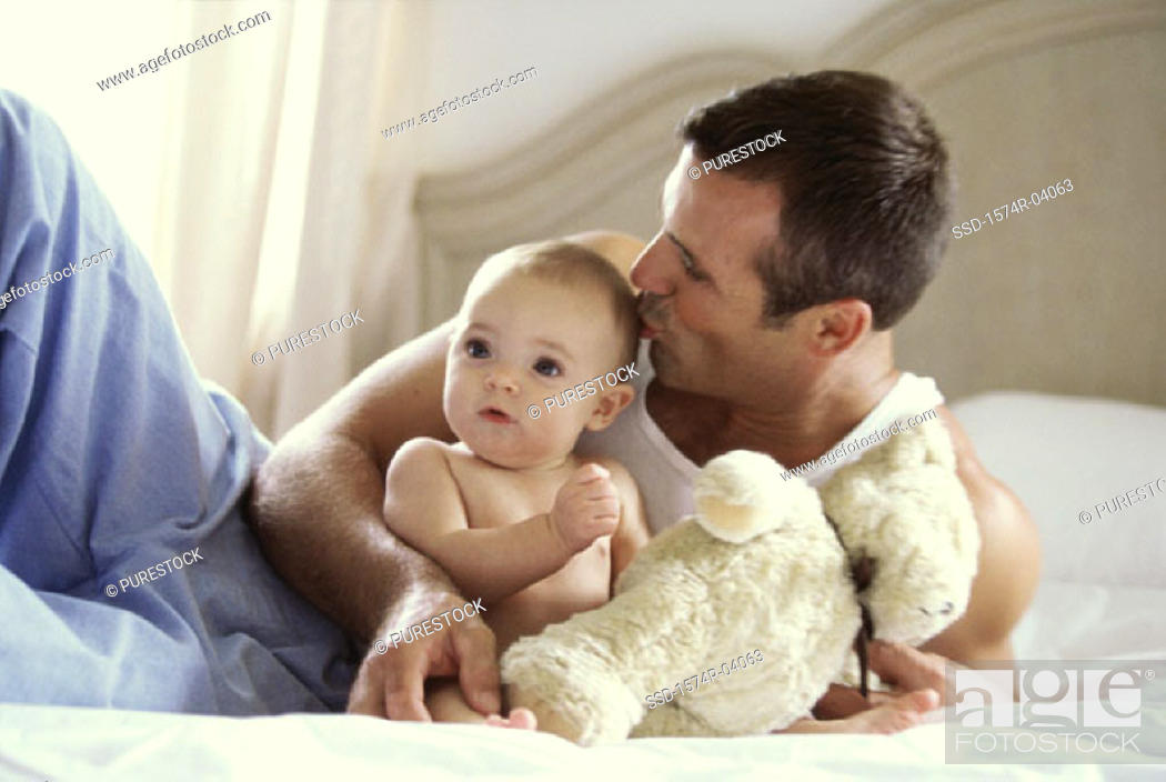 Stock Photo: Father kissing his baby boy.