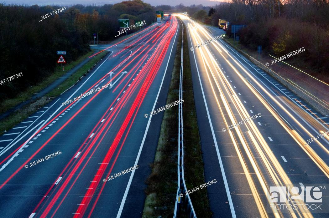 Stock Photo: wide angle of light trails on a busy main road in the evening.