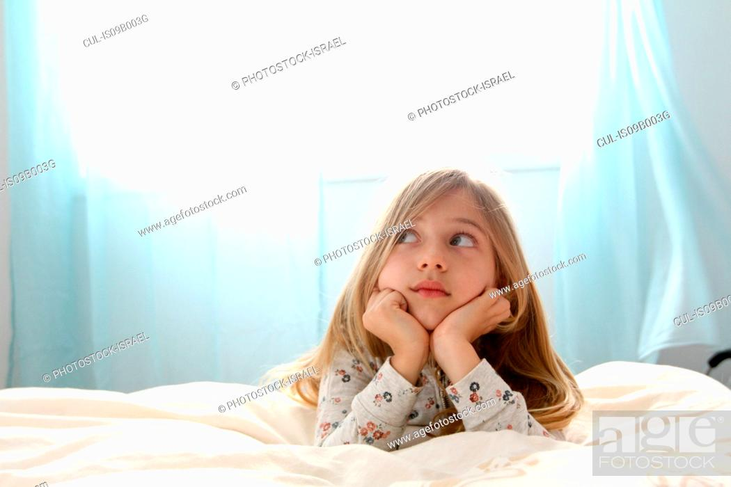 Stock Photo: Girl daydreaming in bed.