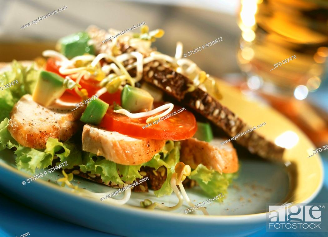 Stock Photo: Salad with fried chicken and wholemeal bread.