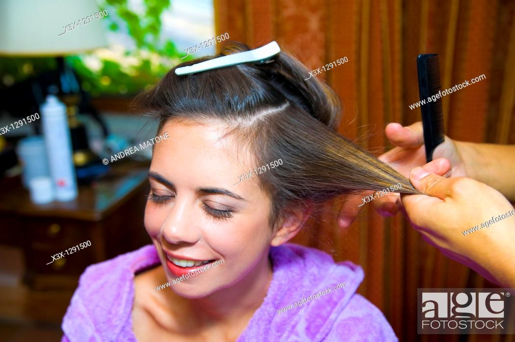 Stock Photo: Woman at a salon during hair styling.