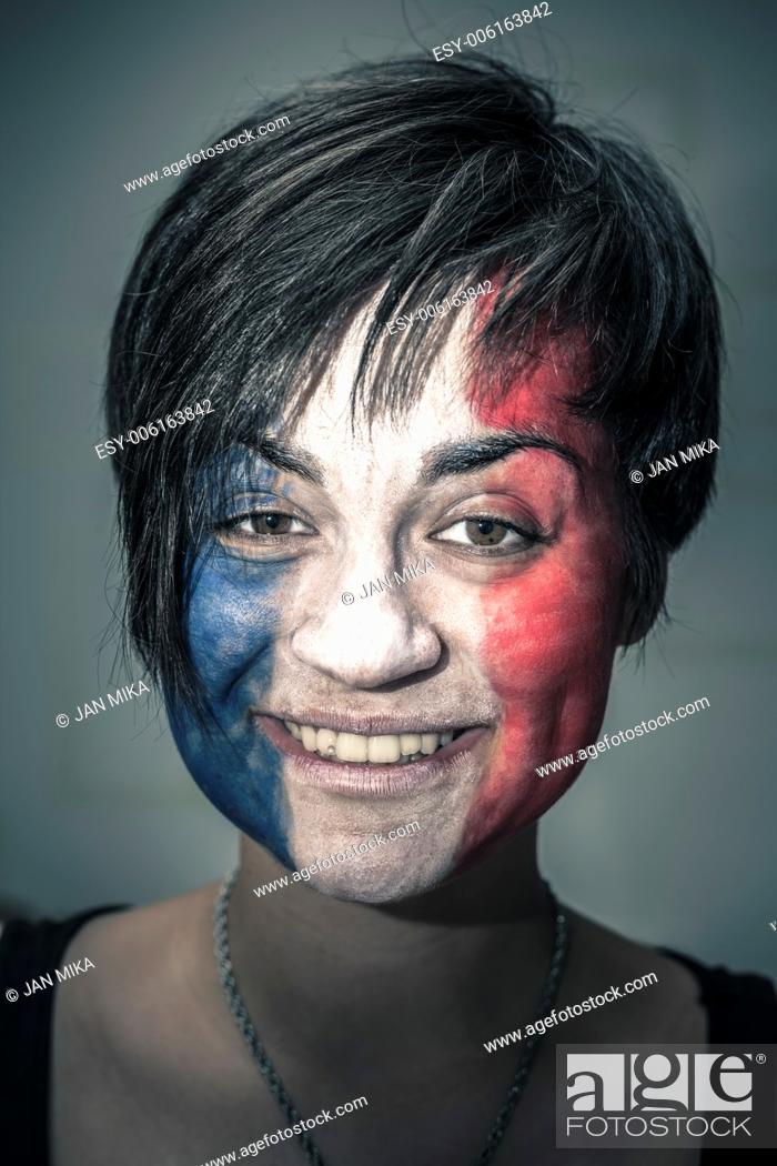 Imagen: Portrait of happy woman with flag of France painted on face.