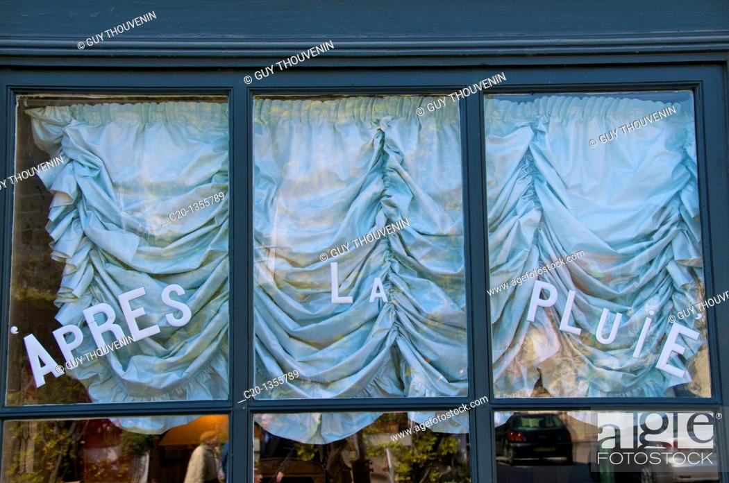 Stock Photo: Window shop with draped curtains and enamel letters Beaumont en Auge Calvados 14 Normandy France.