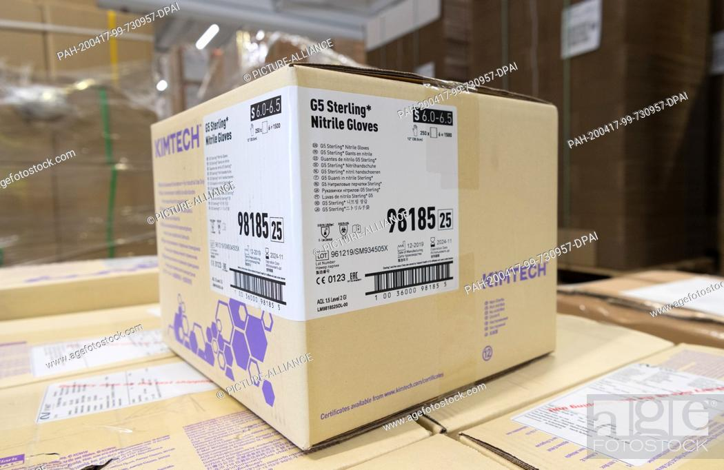 Stock Photo: 16 April 2020, Brandenburg, Großbeeren: A package of G5 Sterling nitrile gloves is available from the logistics service provider Rhenus Warehousing Solutions SE.