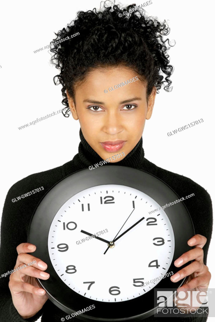 Stock Photo: Portrait of a businesswoman holding a clock.