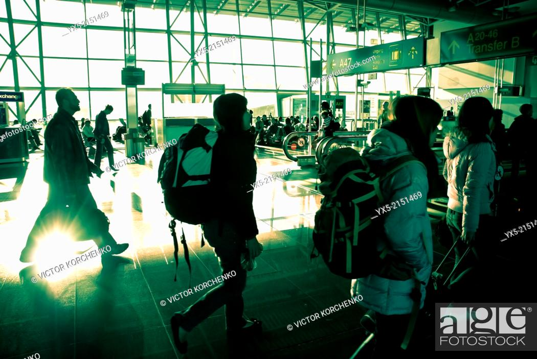 Stock Photo: Passengers walking towards departure gates in Brussels airport.