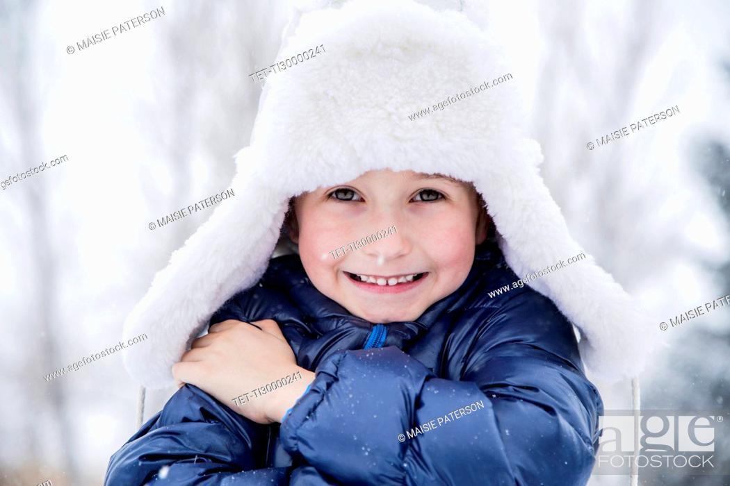 Stock Photo: Portrait of boy (6-7) in fur hat.
