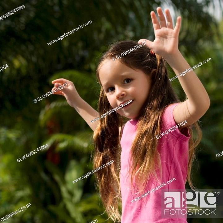 Stock Photo: Close-up of a girl dancing in a park.