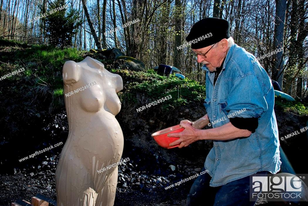 Stock Photo: Gustav Kraitz is glazing a torso by Ulla Kraitz.