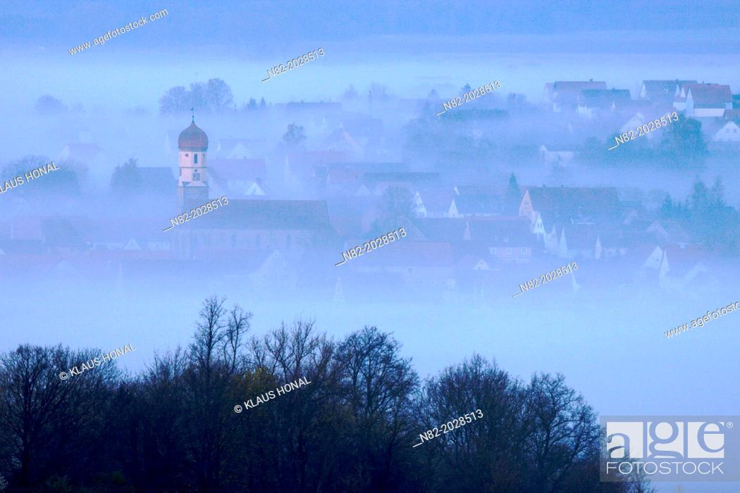 Stock Photo: View from Hesselberg mountain on a small Bavarian village in fog - Region Hesselberg, Bavaria/Germany.