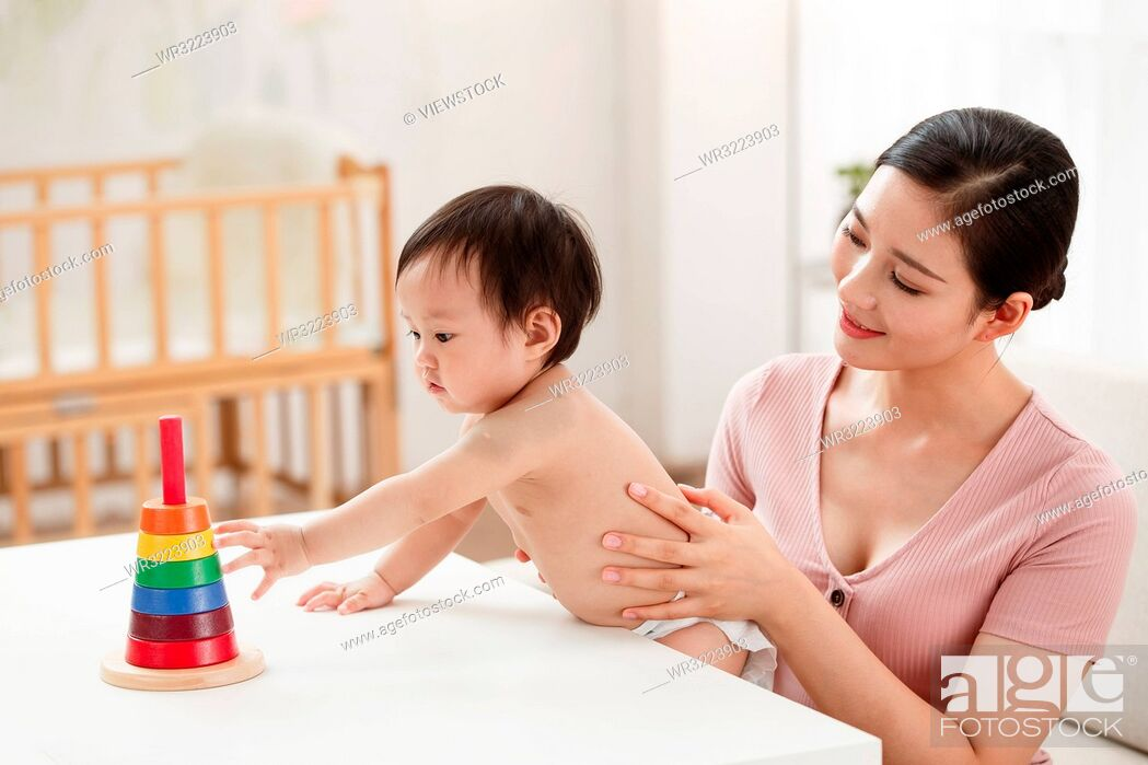 Stock Photo: Mother to accompany baby to play.