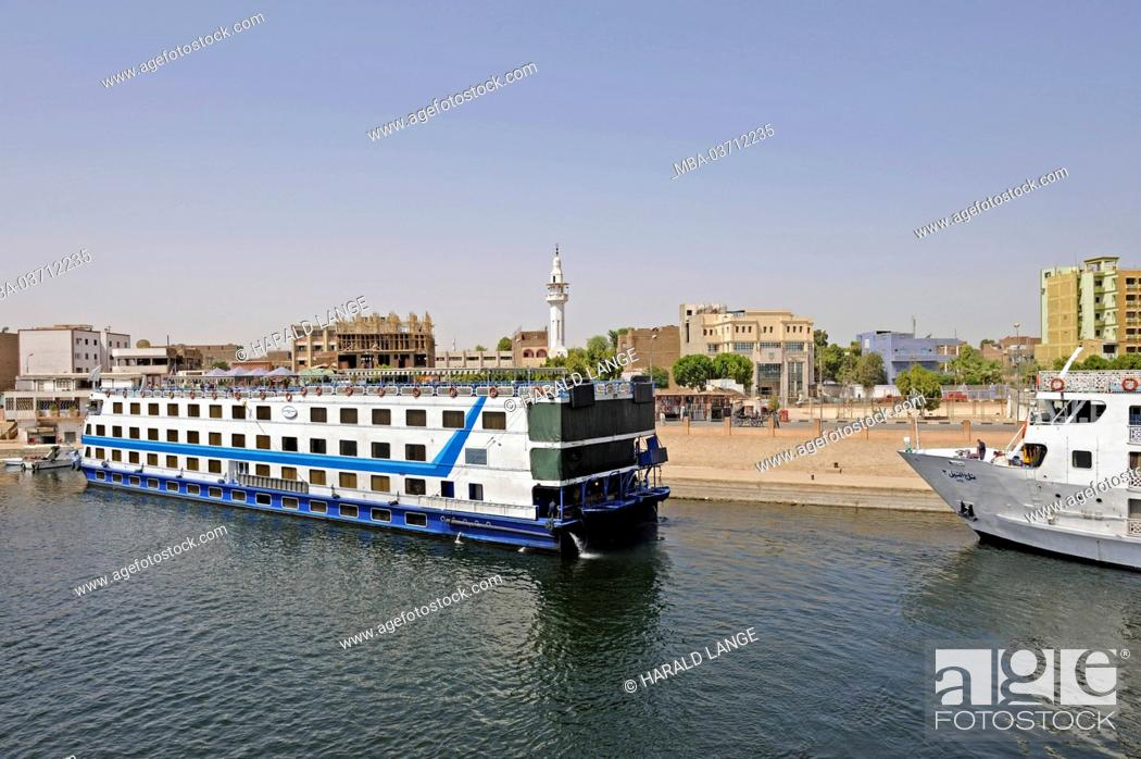 Stock Photo: Cruise ships with vacationers on the Nile in front of Edfu in Egypt,.