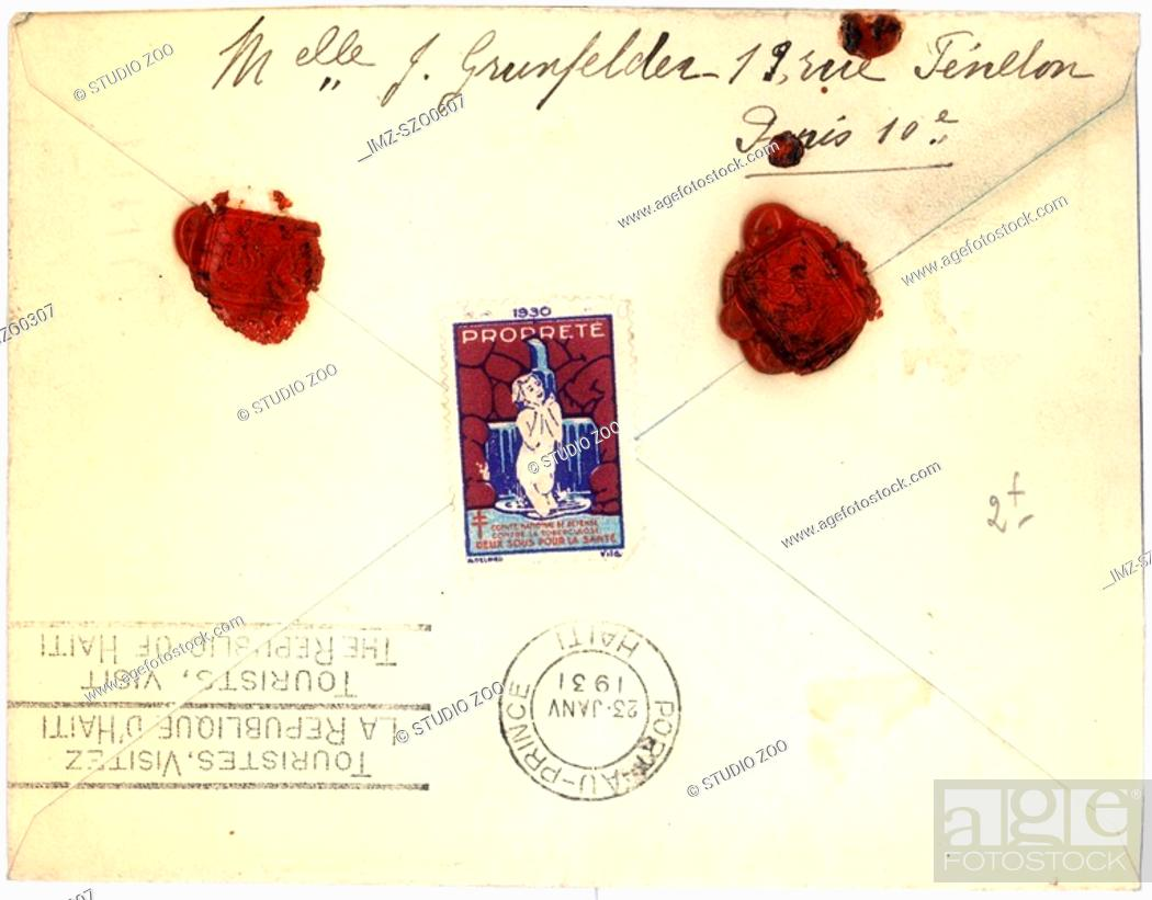 Stock Photo: Vintage envelope with script writing and two red seals, Paris.
