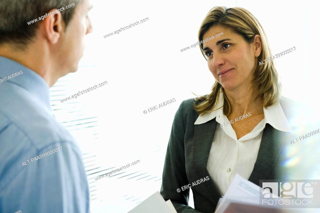 Stock Photo: Businesswoman talking to colleague.