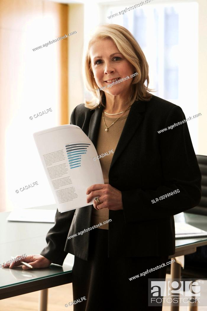 Stock Photo: Mature businesswoman in office, portrait.