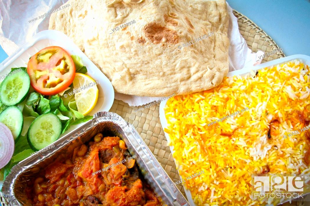Stock Photo: Indian food, Biryani rice with Mutton meat in tomato sauce.