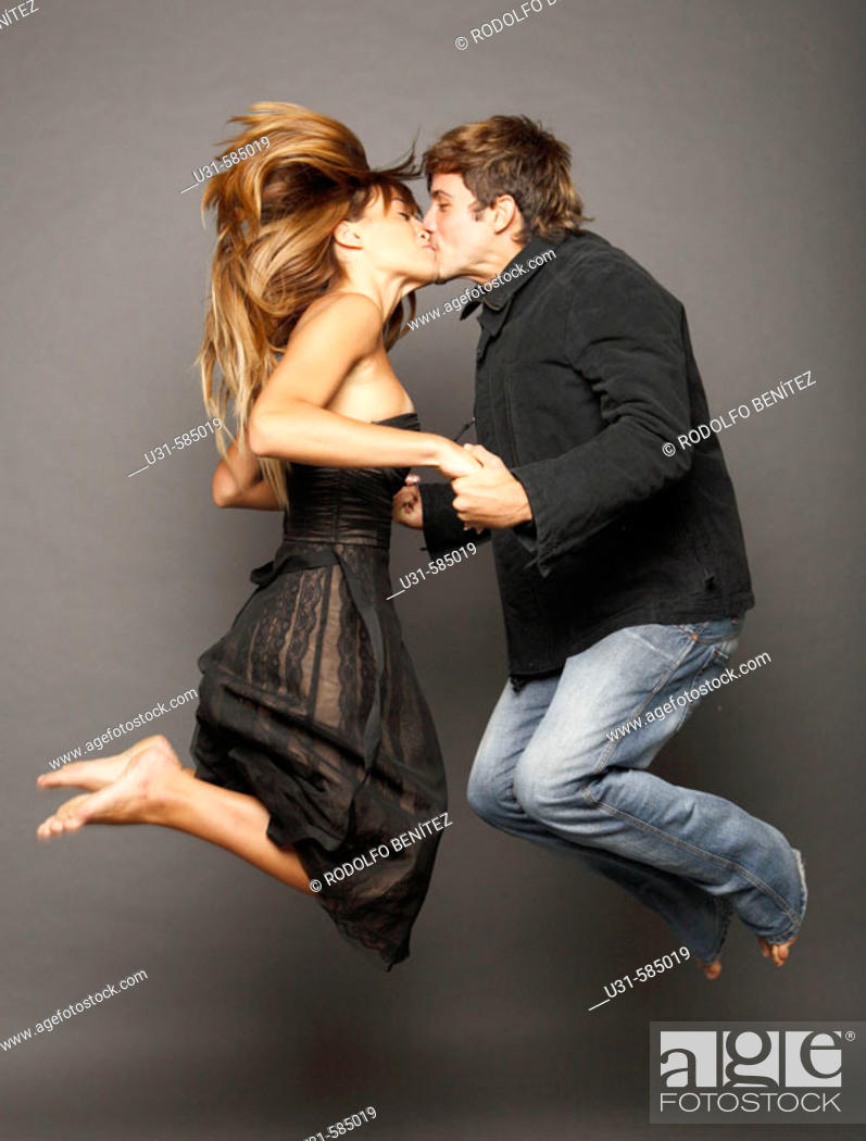 Stock Photo: Young couple kissing in the air.