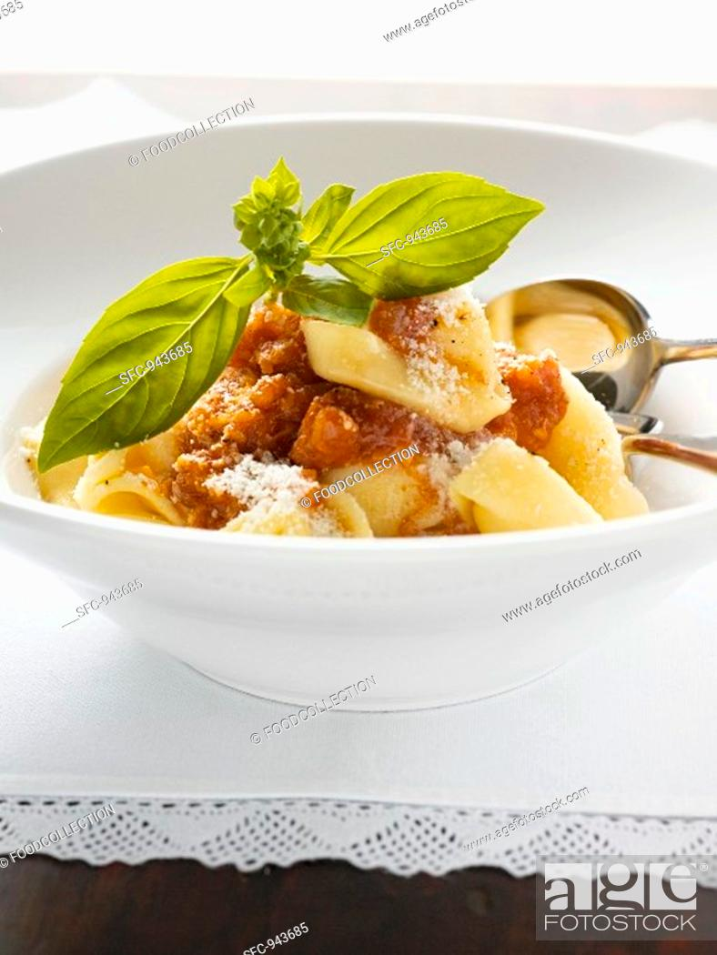 Stock Photo: Tortellini with mince sauce, Parmesan and basil.