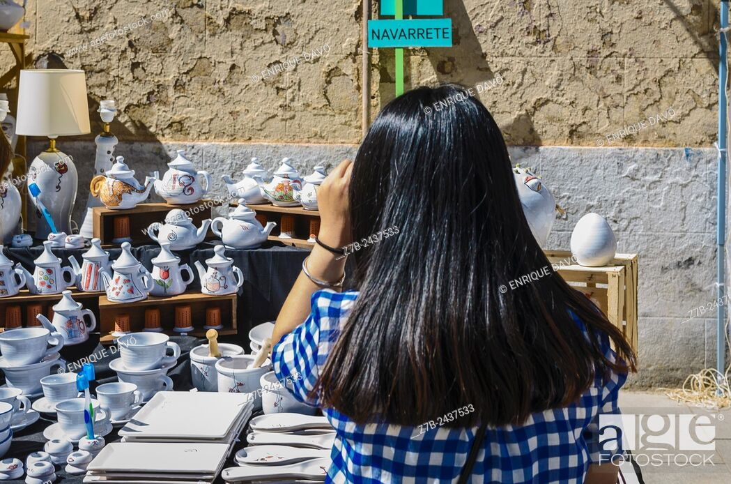 Stock Photo: A black hair of a woman in a pottery fair, Madrid city, Spain.