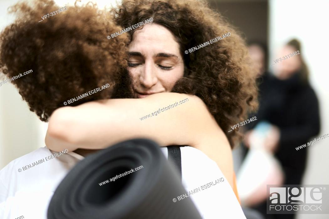 Stock Photo: two women hugging in fitness studio.
