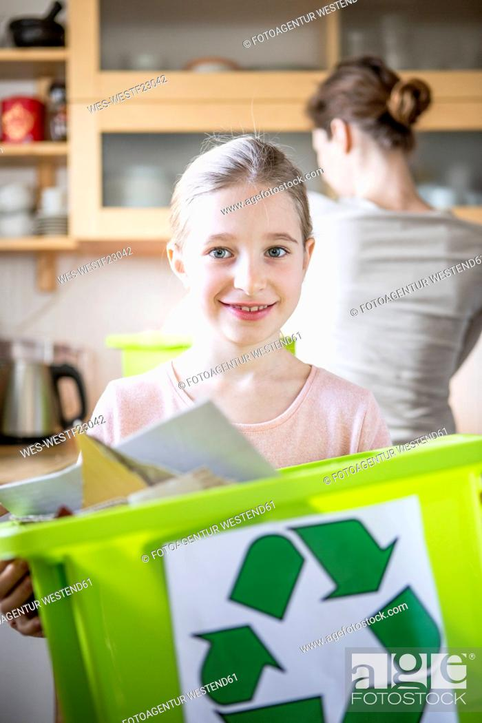 Stock Photo: Portrait of smiling girl at home holding waste box.