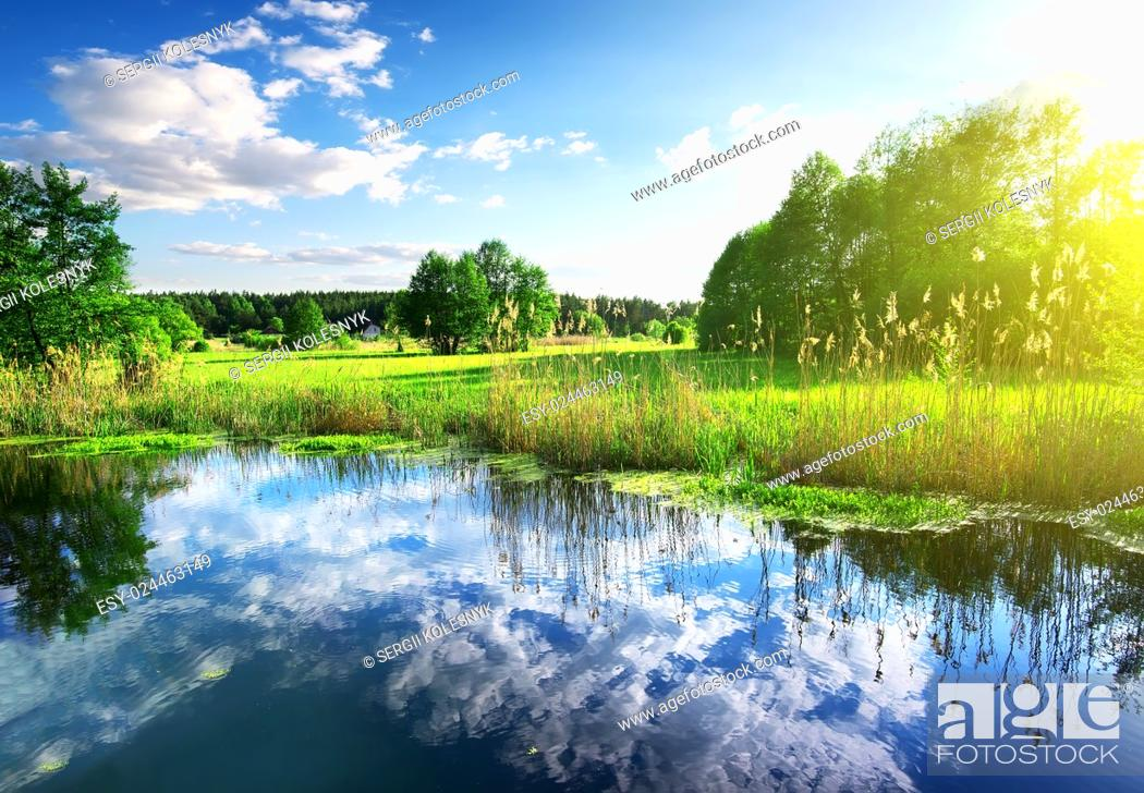 Stock Photo: Reflexion of clouds in the spring river.
