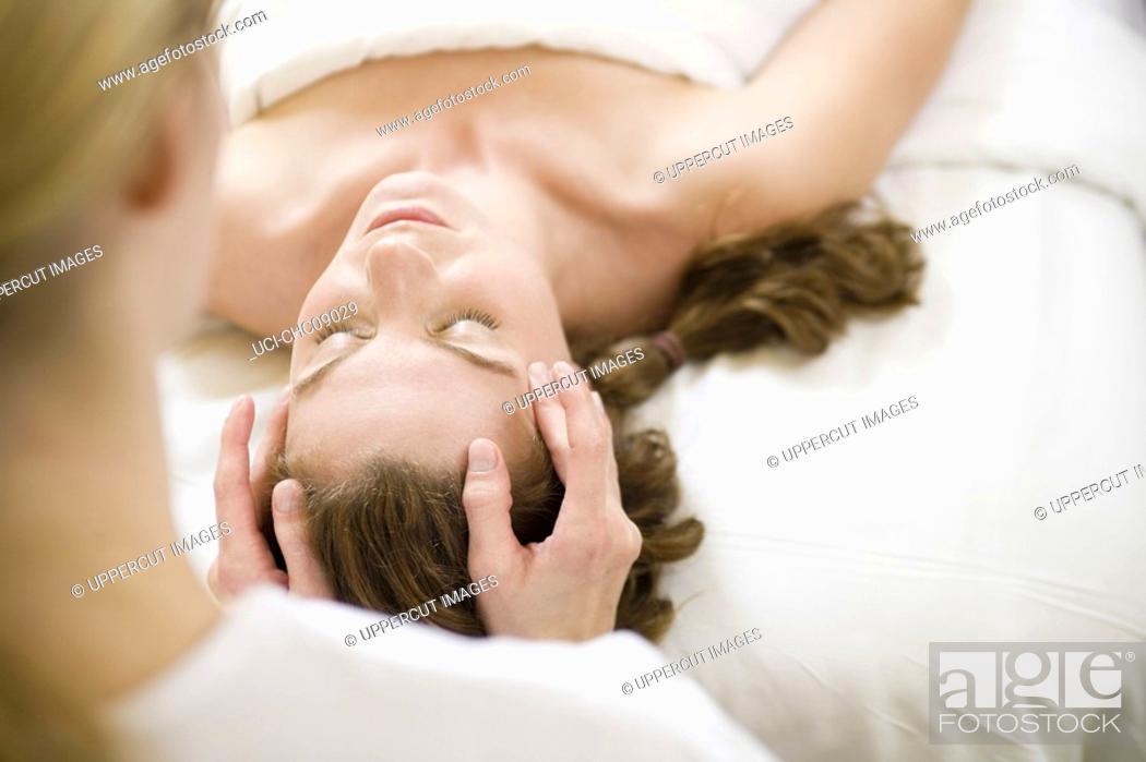 Stock Photo: Woman receiving facial massage.