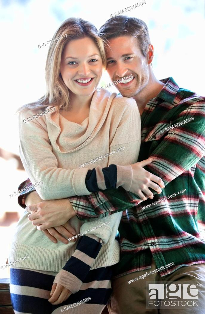 Stock Photo: Portrait of smiling couple hugging.
