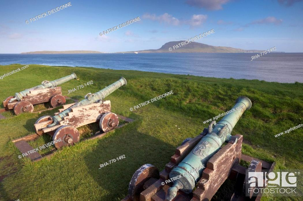 Stock Photo: Skansin fort, old fort guarding Torshavn and its harbour, with old brass cannons, Second World War British marine guns and lighthouse, Nolsoy in the distance.