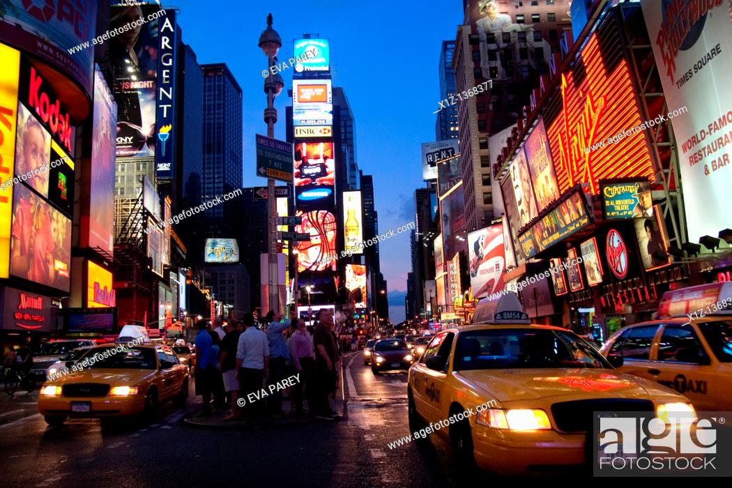Stock Photo: Times Square at night in Manhattan New York City.