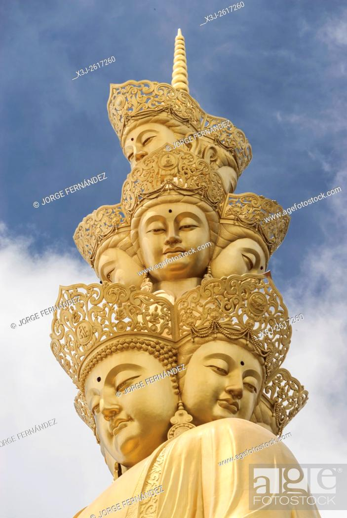 Stock Photo: Golden statue at hte summit of the Emei Shan temple.