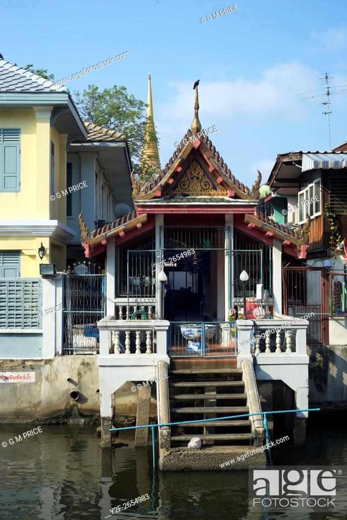 Stock Photo: ornate historic building on canal in Bangkok's old town area.