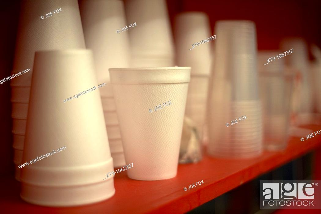 Stock Photo: pile of new polystyrene cups sitting on a red shelf selective focus.