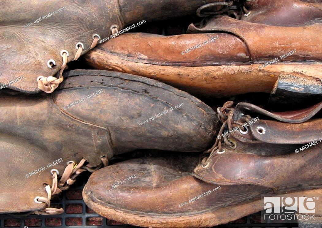 Stock Photo: Working boots, flea market, Narbonne Plage, France.