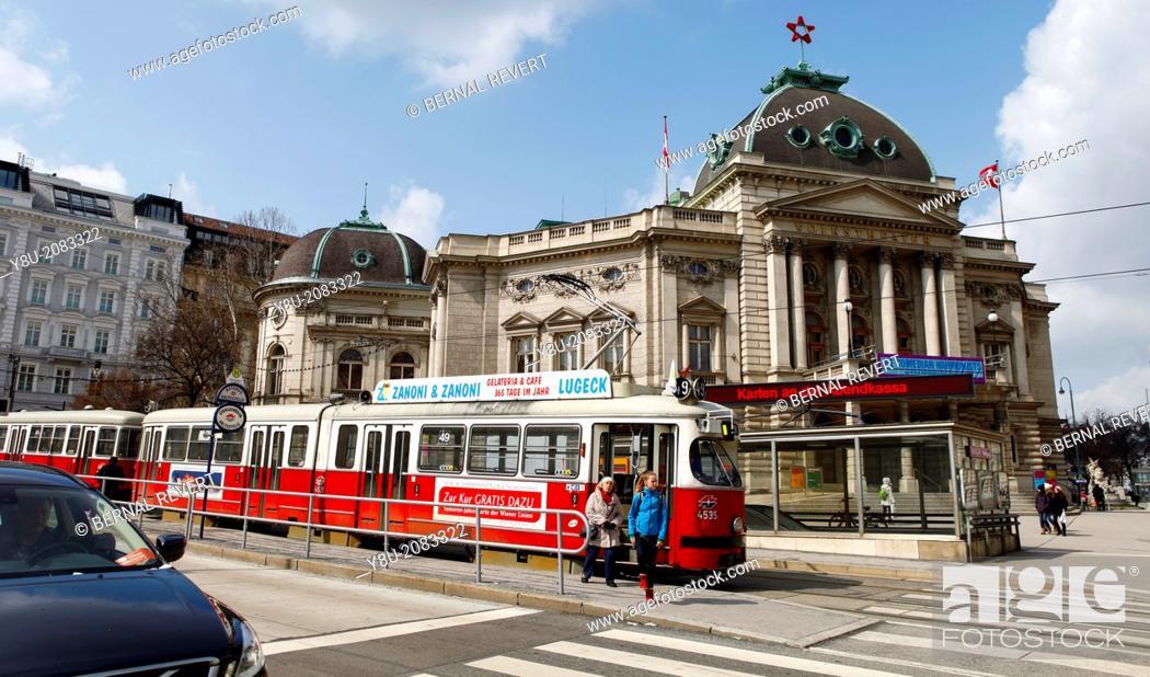 Stock Photo: Tram passing next to Volkstheatre in Vienna.