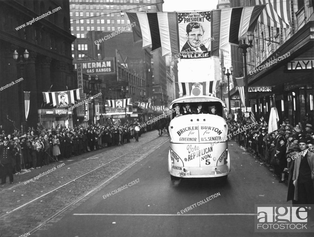 Stock Photo: Republican Election campaign parade in Cleveland, Ohio, Oct. 4, 1940. Euclid Avenue is decorated with Wendell Wilkie banners and crowds spill over the sidewalks.