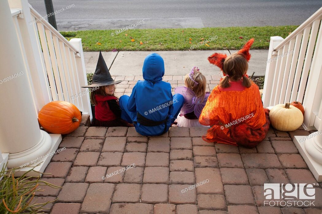 Stock Photo: Children enjoying treats on steps.