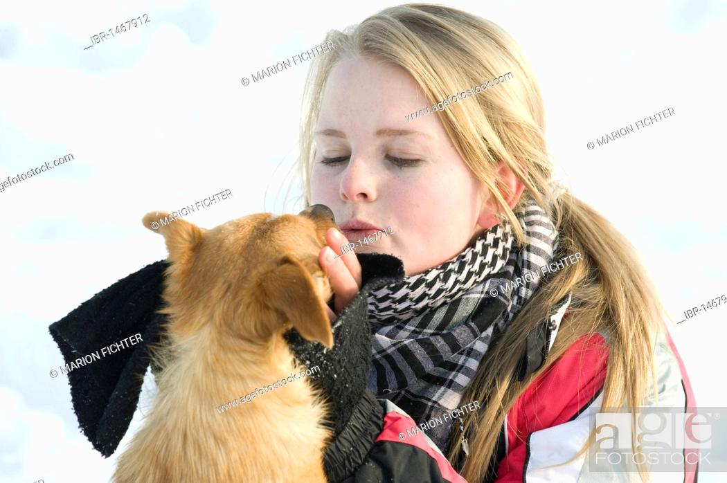 Stock Photo: Girl, teenager with a small dog, winter.